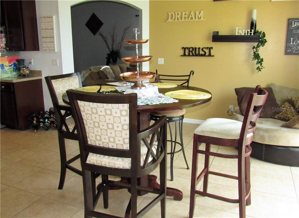 Dining area has sliders that lead to the back patio and a view of the lake - Single Family Home for sale at 24041 Canal St, Port Charlotte, FL 33980 - MLS Number is C7400879