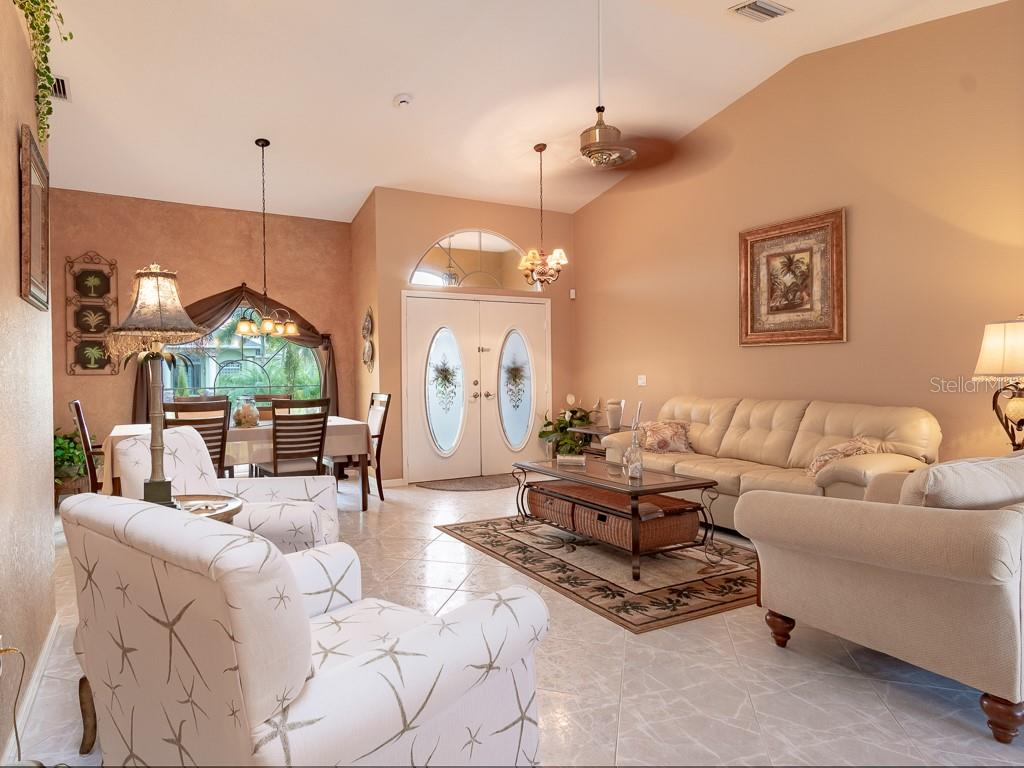 Your living room and formal dining room - Single Family Home for sale at 15464 Avery Rd, Port Charlotte, FL 33981 - MLS Number is C7401914