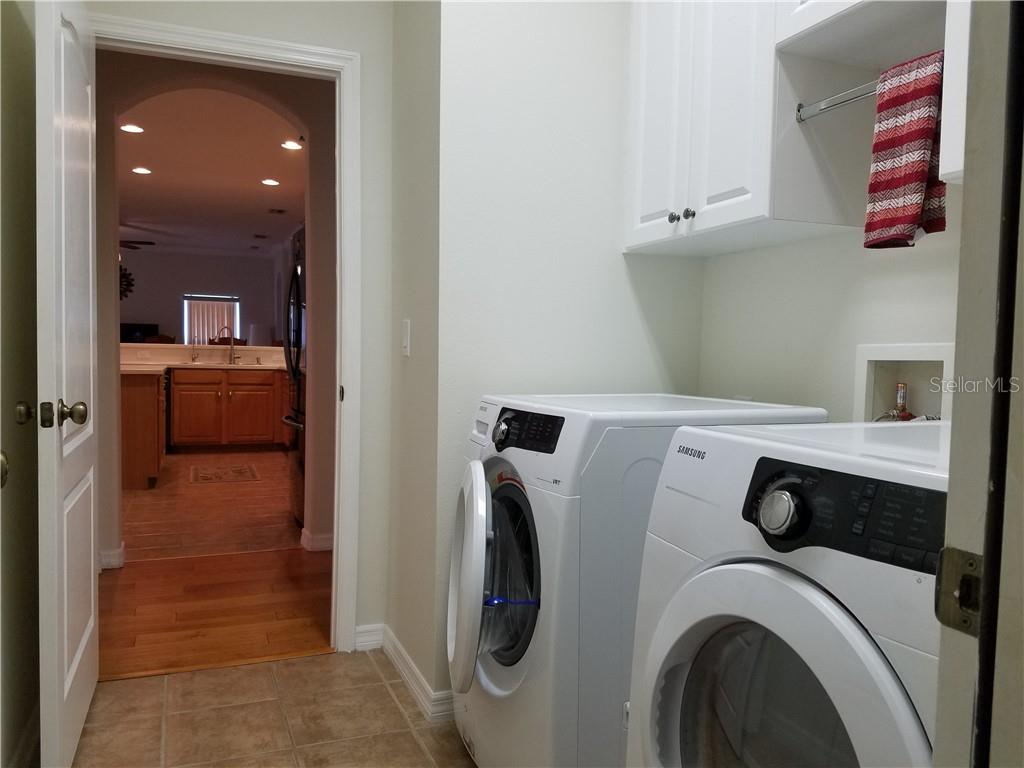 The laundry room is centrally located and features a new washer and dryer. - Single Family Home for sale at 2752 Suncoast Lakes Blvd, Punta Gorda, FL 33980 - MLS Number is C7402671