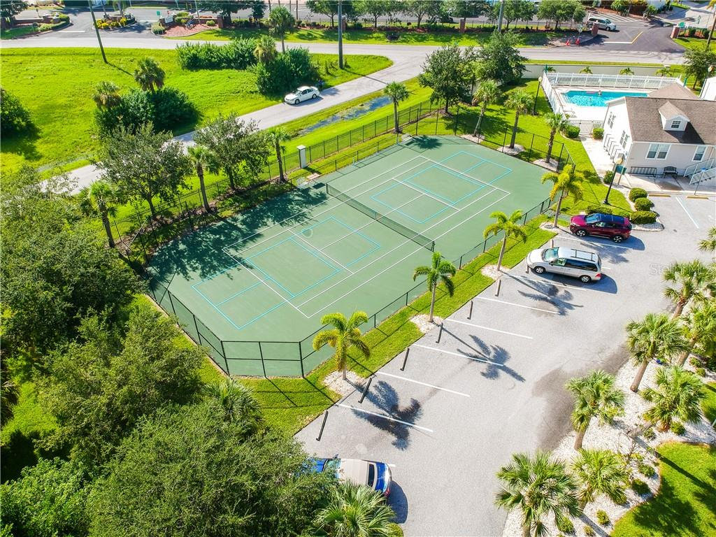 View of the tennis court - Single Family Home for sale at 8663 Lake Front Ct, Punta Gorda, FL 33950 - MLS Number is C7403960