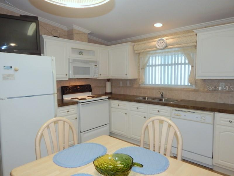 Good storage in the kitchen - Manufactured Home for sale at 66 Windmill Blvd, Punta Gorda, FL 33950 - MLS Number is C7405183