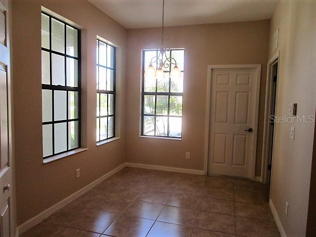 STRAIGHT ON VIEW OF EATING AREA IN KITCHEN (DOOR FAR IFHT IS LAUNDRY AND REAR IS GARAGE - Villa for sale at 1486 Maseno Dr, Venice, FL 34292 - MLS Number is C7405922