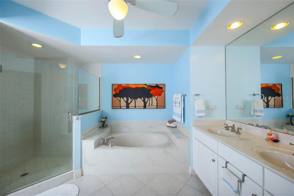 Frameless glass enclosed shower, soaking tub, and dual sinks will be the perfect place to pamper yourself in this tranquil & soothing master bath. - Condo for sale at 3329 Sunset Key Cir #503, Punta Gorda, FL 33955 - MLS Number is C7406727