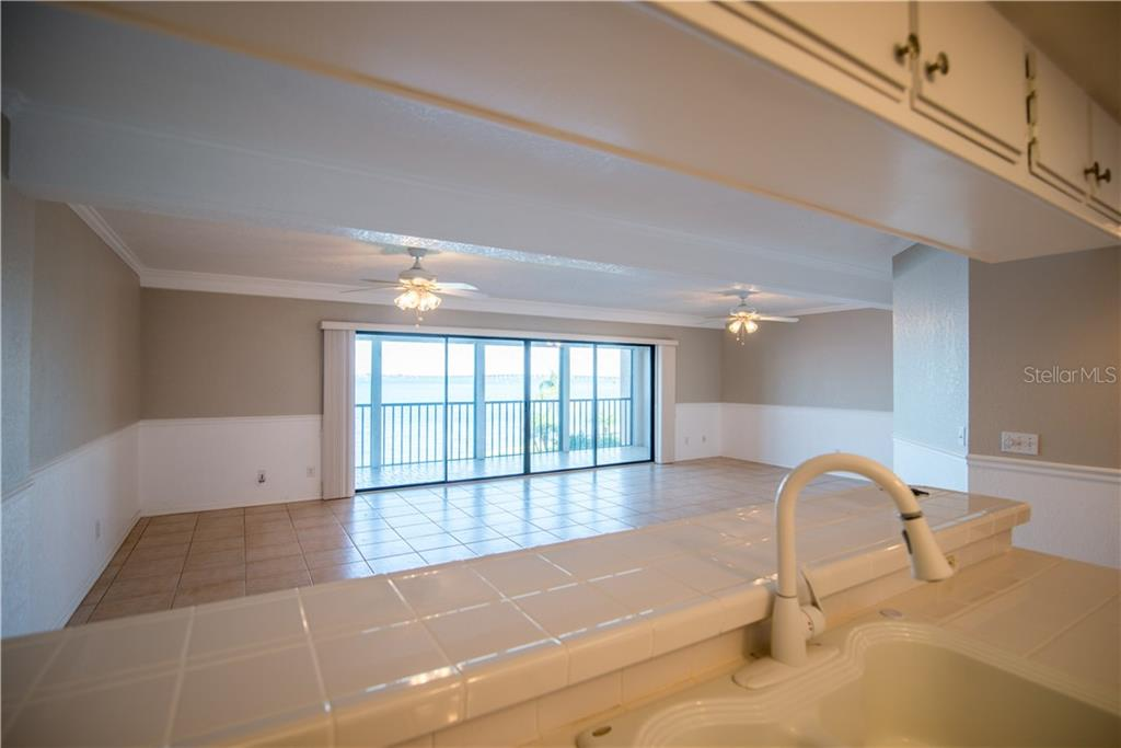 This open floor plan creates an inviting space to relax and enjoy in your light and bright home. - Condo for sale at 1601 Park Beach Cir #112 / 2, Punta Gorda, FL 33950 - MLS Number is C7407435