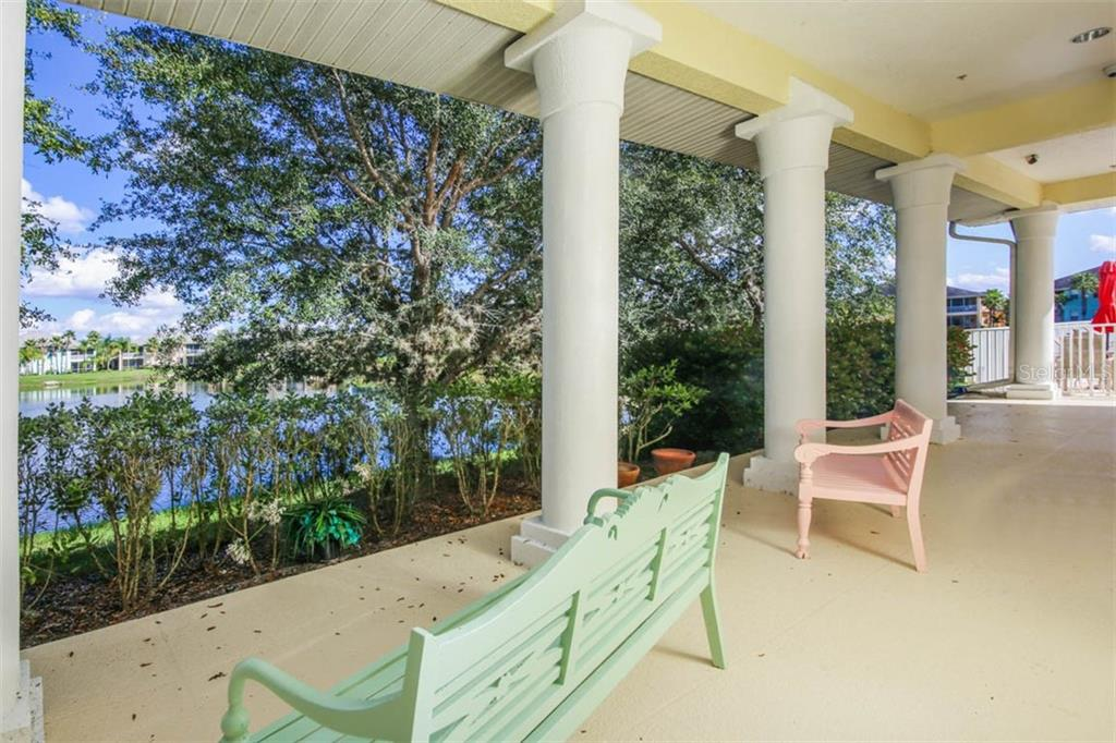 Lake side veranda at the Club House - Condo for sale at 2040 Willow Hammock Cir #b208, Punta Gorda, FL 33983 - MLS Number is C7408424