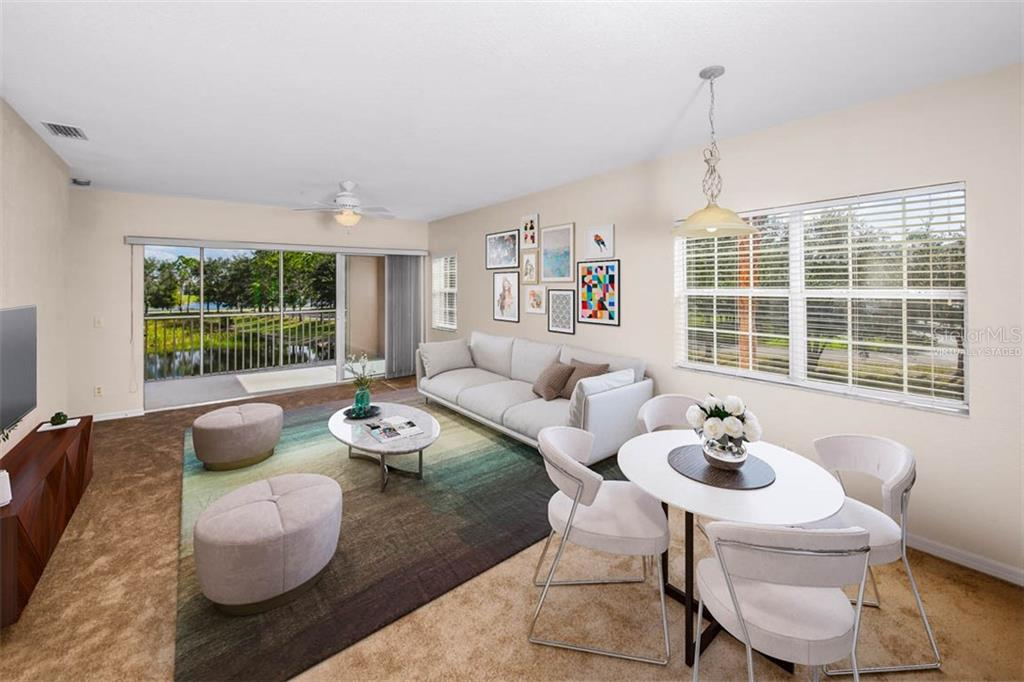 Virtually staged Great Room flows to the encompassing lake views. - Condo for sale at 2040 Willow Hammock Cir #b208, Punta Gorda, FL 33983 - MLS Number is C7408424