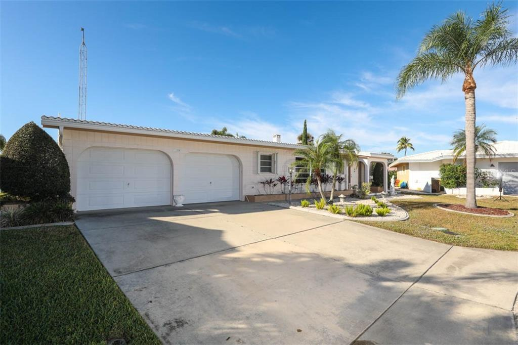 Double door garage at front - Single Family Home for sale at 2291 Bayview Rd, Punta Gorda, FL 33950 - MLS Number is C7409445