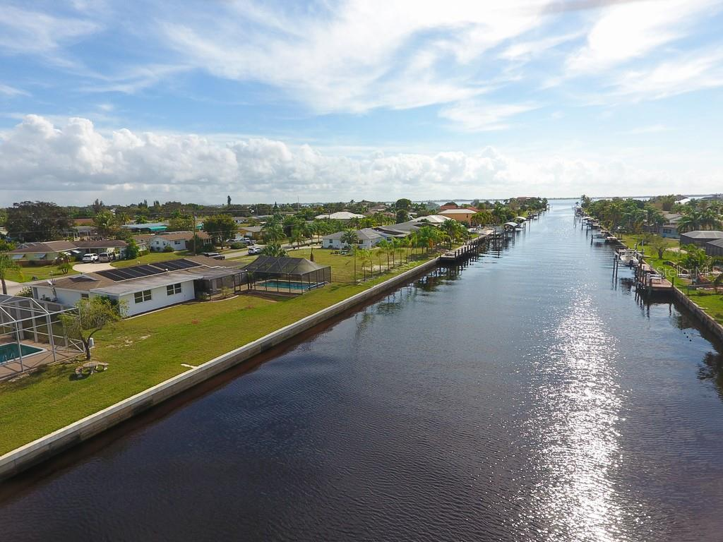 Looking down the canal to the Peace River - Single Family Home for sale at 126 Bangsberg Rd Se, Port Charlotte, FL 33952 - MLS Number is C7409866
