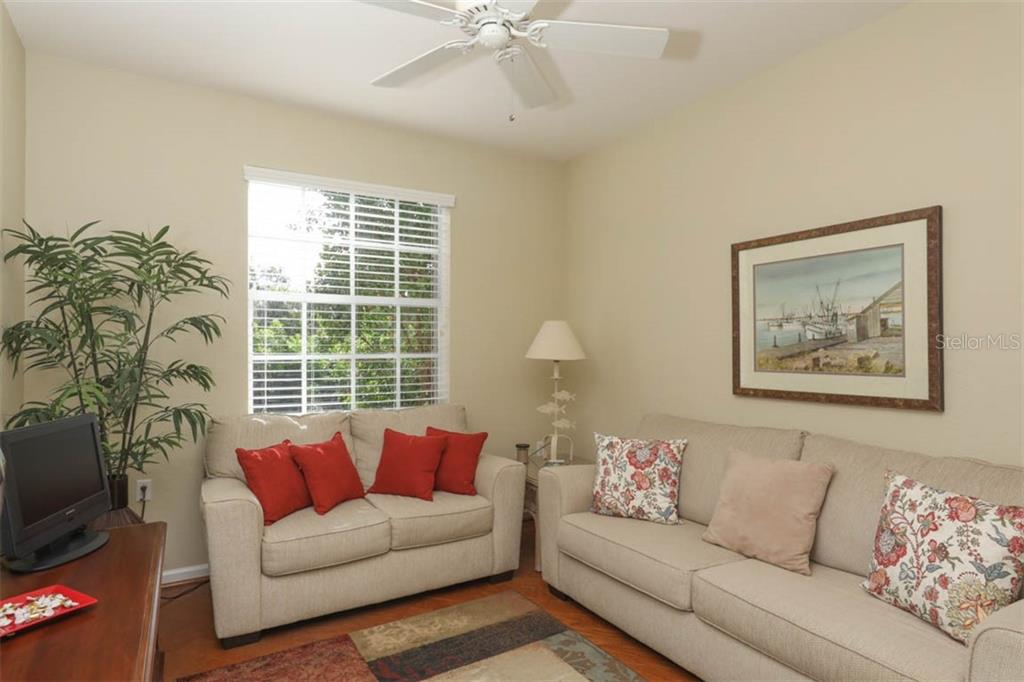 Den or office.  Lovely laminate wood flooring. Large sofa is a sleeper sofa - Condo for sale at 4643 Club Dr #102, Port Charlotte, FL 33953 - MLS Number is C7413207