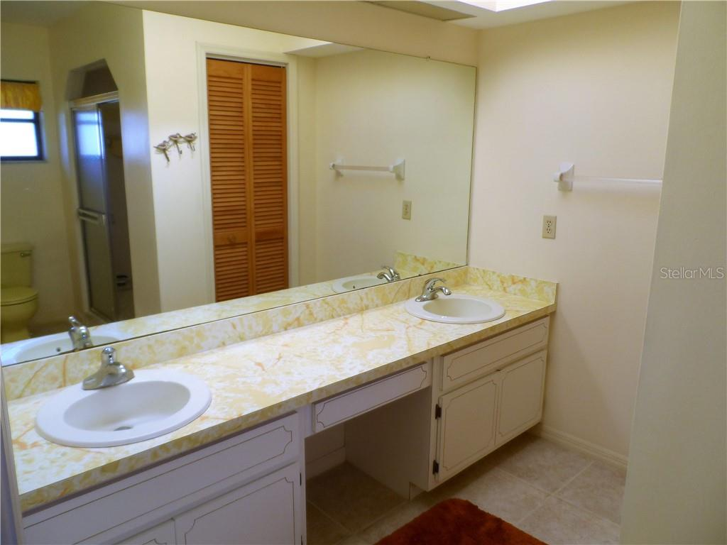 Master Bathroom has walk in shower, dual sinks and a Linen closet - Single Family Home for sale at 24126 Santa Inez Rd, Punta Gorda, FL 33955 - MLS Number is C7416081