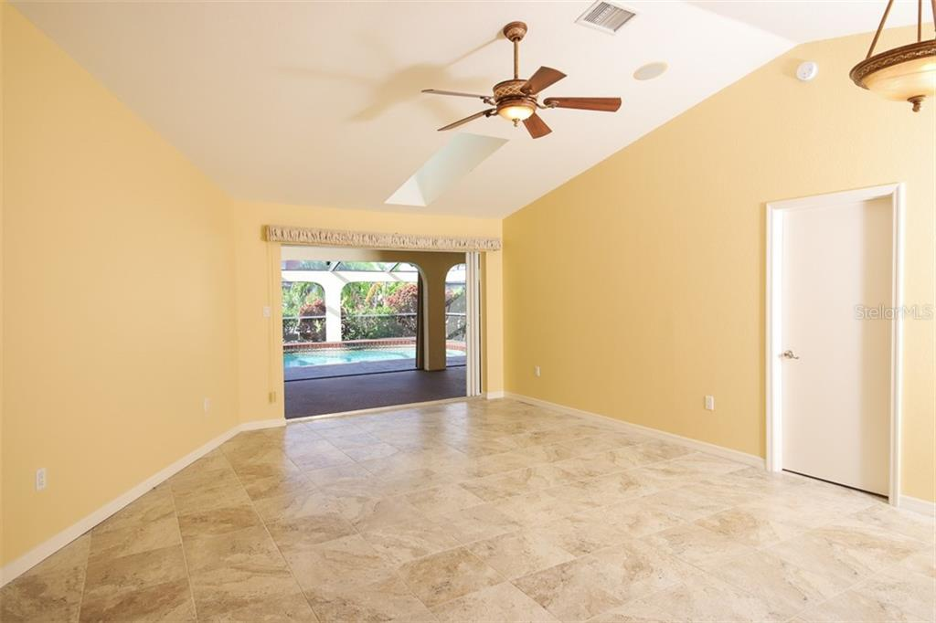 Pool with Lanai & stacking slider of owner suite - Single Family Home for sale at 2713 Saint Thomas Dr, Punta Gorda, FL 33950 - MLS Number is C7417491