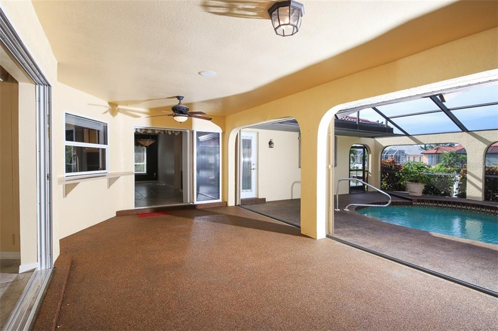 Virtually staged. Living Room has stacking slider out to huge Lanai & pool area. - Single Family Home for sale at 2713 Saint Thomas Dr, Punta Gorda, FL 33950 - MLS Number is C7417491