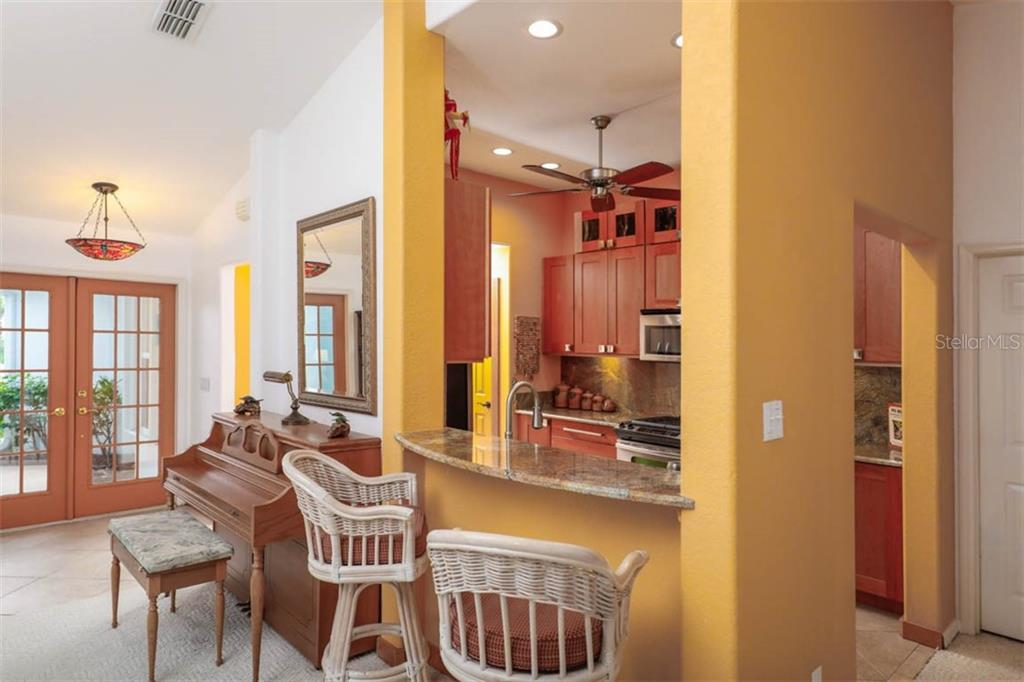 A handy breakfast bar will keep your guests out of the kitchen during meal prep time, but still allows the chef to converse with guests. - Single Family Home for sale at 1633 Islamorada Blvd, Punta Gorda, FL 33955 - MLS Number is C7418555