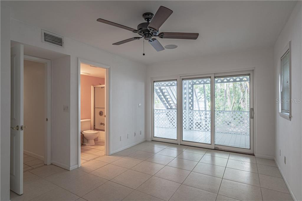 Lower level master #3 with impact glass sliding doors to the lower back porch - Single Family Home for sale at 124 Useppa Is, Captiva, FL 33924 - MLS Number is C7419408