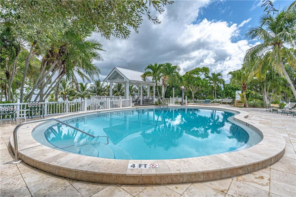 Community Pool behind the Collier Inn - Single Family Home for sale at 124 Useppa Is, Captiva, FL 33924 - MLS Number is C7419408