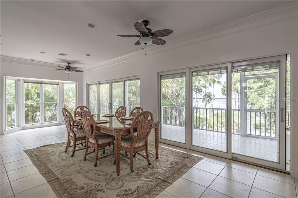 Dining room with access to the back porch - Single Family Home for sale at 124 Useppa Is, Captiva, FL 33924 - MLS Number is C7419408
