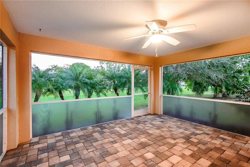 A lovely view out the lanai with pavers - Single Family Home for sale at 2440 Montpelier Rd, Punta Gorda, FL 33983 - MLS Number is C7421011