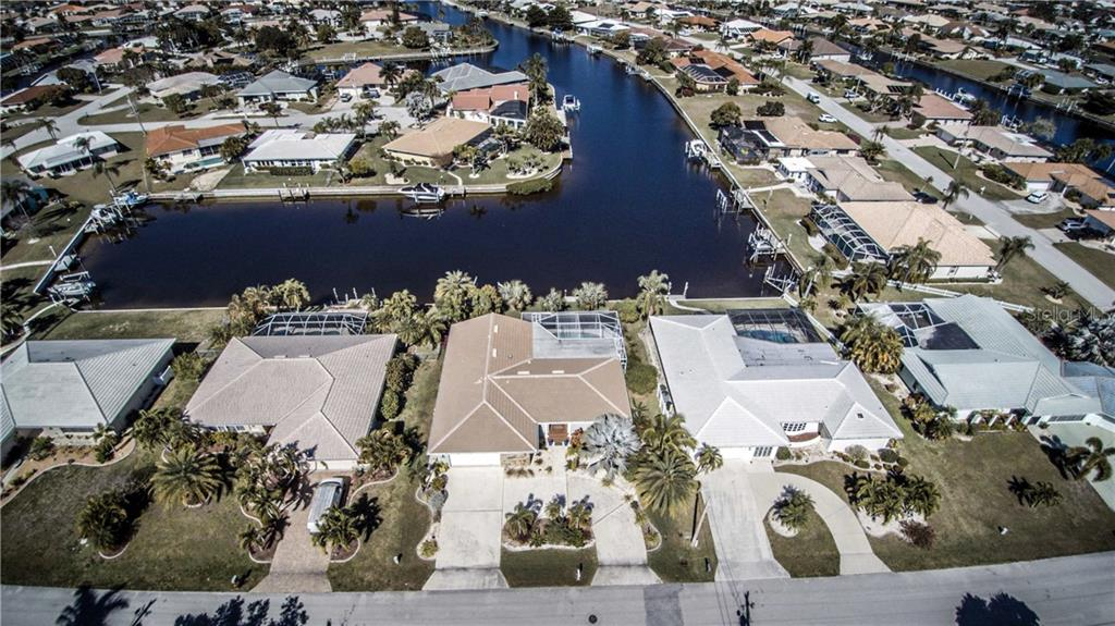 Wide intersecting canal basin leads to an easy out for an enjoyable day on the Harbor, docking at the Boca Grande sandbars or deep sea fishing in the Gulf of Mexico. - Single Family Home for sale at 1440 Appian Dr, Punta Gorda, FL 33950 - MLS Number is C7425399