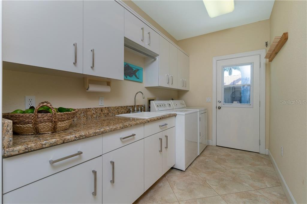 WELL APPOINTED LAUNDRY ROOM WITH UTILITY SINK, PLENTY OF STORAGE AND SIDE ENTRY FROM OUTSIDE - Single Family Home for sale at 3537 Caya Largo Ct, Punta Gorda, FL 33950 - MLS Number is C7431664