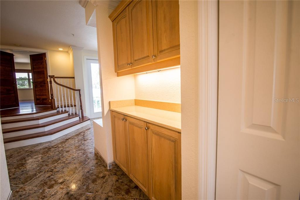 Off the kitchen is a pass-through hallway with a half-bath and additional storage (can you ever have enough?). - Condo for sale at 4410 Warren Ave #511, Port Charlotte, FL 33953 - MLS Number is C7432222