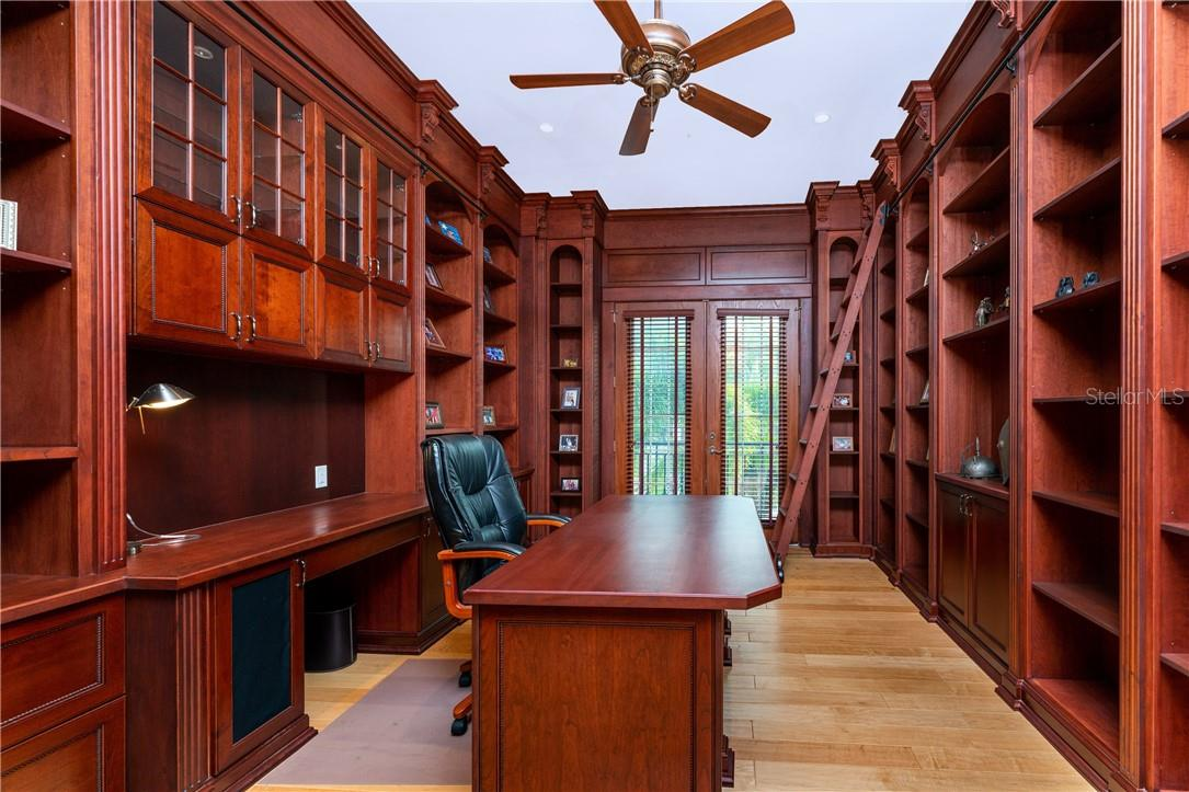 Cherry wood panelled library with maple hardwood flooring - Single Family Home for sale at 7440 Riverside Dr, Punta Gorda, FL 33982 - MLS Number is C7436263