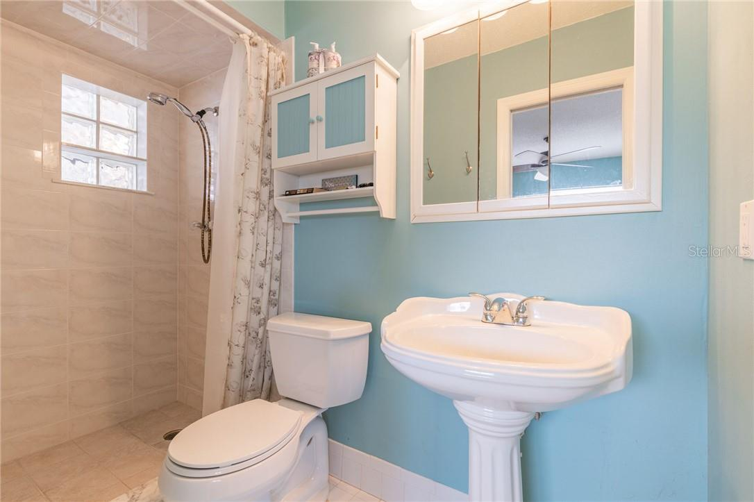 Owners bath with updated step in shower, new comfort toilet and pedestal sink. - Single Family Home for sale at 24368 Blackbeard Blvd, Punta Gorda, FL 33955 - MLS Number is C7436898