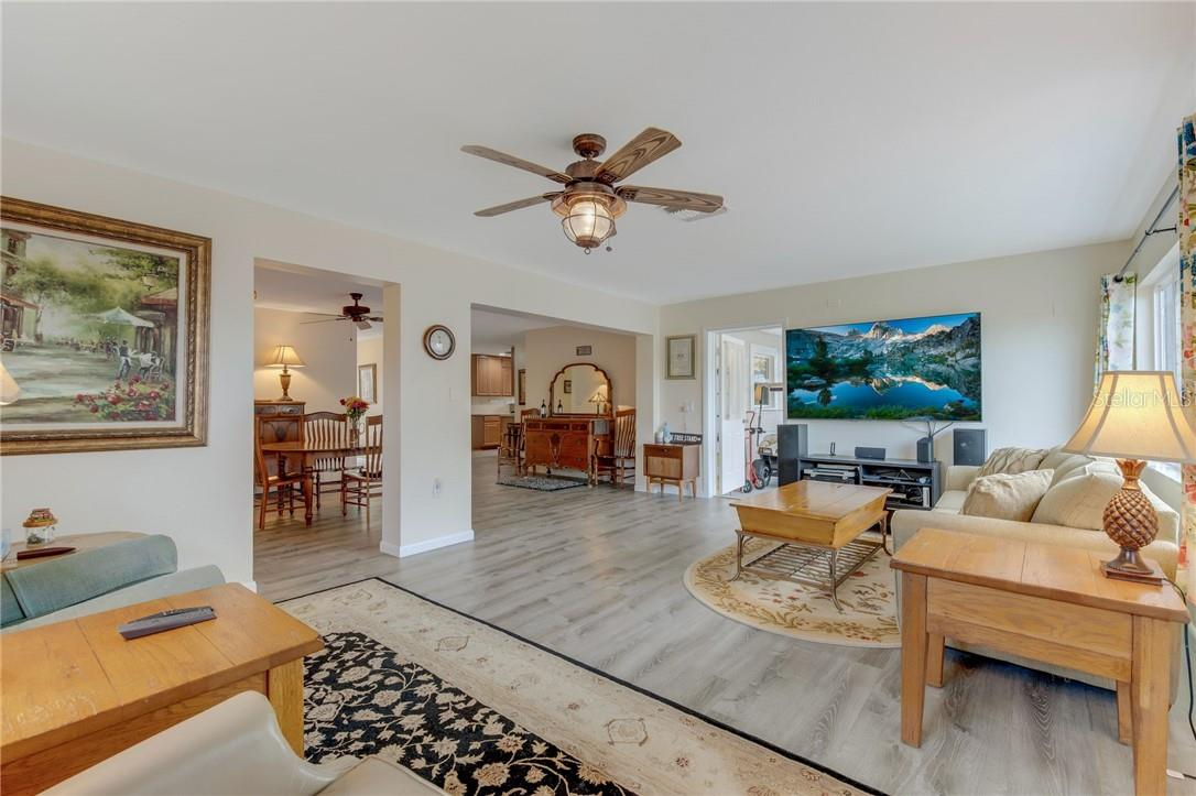 Living area looking back to dining room and kitchen beyond. Open and spacious with wonderful traffic flow. - Single Family Home for sale at 24368 Blackbeard Blvd, Punta Gorda, FL 33955 - MLS Number is C7436898