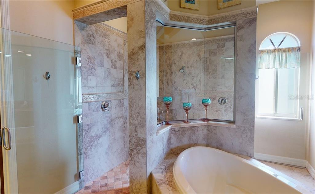 Gorgeous tiled shower. - Single Family Home for sale at 4245 Spire St, Port Charlotte, FL 33981 - MLS Number is C7437570
