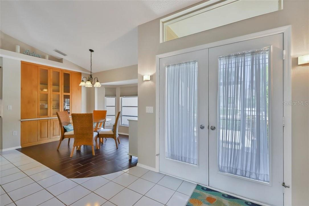 as you enter the double doors to your right is the built in buffet with glass front doors, great space saver - Single Family Home for sale at 116 Mariner Ln, Rotonda West, FL 33947 - MLS Number is C7441260