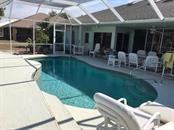 Single Family Home for sale at 1493 Rio De Janeiro Ave, Punta Gorda, FL 33983 - MLS Number is C7239470