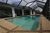Screened solar heated pool - Single Family Home for sale at 2601 Parisian Ct, Punta Gorda, FL 33950 - MLS Number is C7244389
