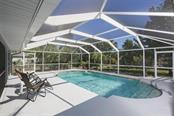 Large caged pool with plenty of space for sunning and relaxing - Single Family Home for sale at 4407 Albacore Cir, Port Charlotte, FL 33948 - MLS Number is C7245070