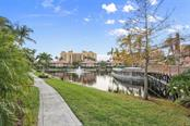 A nice walking path surrounds the lagoon and island pool!  There is another walking path that surrounds the Prosperity Point Peninsula that provides views of boats moored in each of the basins. - Condo for sale at 3392 Sunset Key Cir #b, Punta Gorda, FL 33955 - MLS Number is C7249092