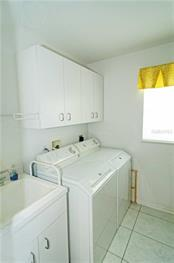 Large laundry room  (10 x 8.5)with pull-down ironing board (not shown) - Single Family Home for sale at 9199 Key West St, Port Charlotte, FL 33981 - MLS Number is C7403206