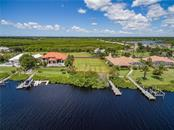 Parcel #4 is shown in the private subdivision of Lea Marie Island, looking across the East Spring Waterway. All overhead drone pictures are from July, 2018. - Vacant Land for sale at 4030 Lea Marie Island Dr, Port Charlotte, FL 33952 - MLS Number is C7404124