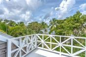 Views from the upper level master private balcony- the perfect morning coffee location - Single Family Home for sale at 124 Useppa Is, Captiva, FL 33924 - MLS Number is C7419408