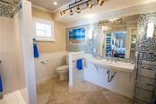 New large sink and beautiful tile spotlight this bright, light ensuite bath. - Single Family Home for sale at 1440 Appian Dr, Punta Gorda, FL 33950 - MLS Number is C7425399