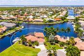 LARGE TIP LOT WITH BASIN AND INTERSECTING CANAL WATER VIEWS - Single Family Home for sale at 3537 Caya Largo Ct, Punta Gorda, FL 33950 - MLS Number is C7431664