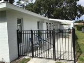 Rear 64' long Courtyard - Single Family Home for sale at 1302 Pinebrook Way, Venice, FL 34285 - MLS Number is C7435367