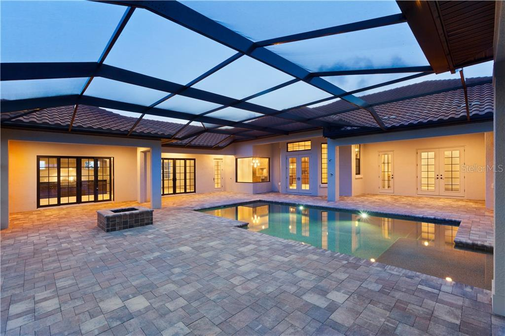 The Newlane Outdoor Living Area with Fire Pit - Single Family Home for sale at 19422 Newlane Pl, Bradenton, FL 34202 - MLS Number is A4159907