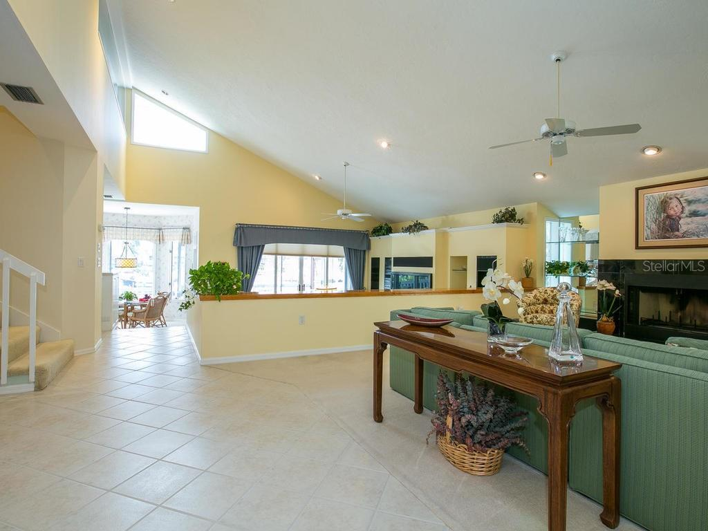 Living/Family room with fireplace - Single Family Home for sale at 1272 Riegels Landing Dr, Sarasota, FL 34242 - MLS Number is A4160033