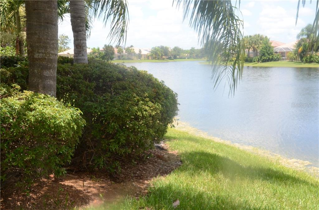 This is a view down the lake from your new back yard. - Single Family Home for sale at 13328 Coluccio St, Venice, FL 34293 - MLS Number is A4160649