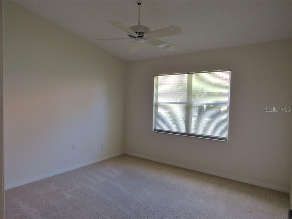 2nd Bedroom with cathedral ceiling. - Villa for sale at 4552 Deer Trail Blvd, Sarasota, FL 34238 - MLS Number is A4161593