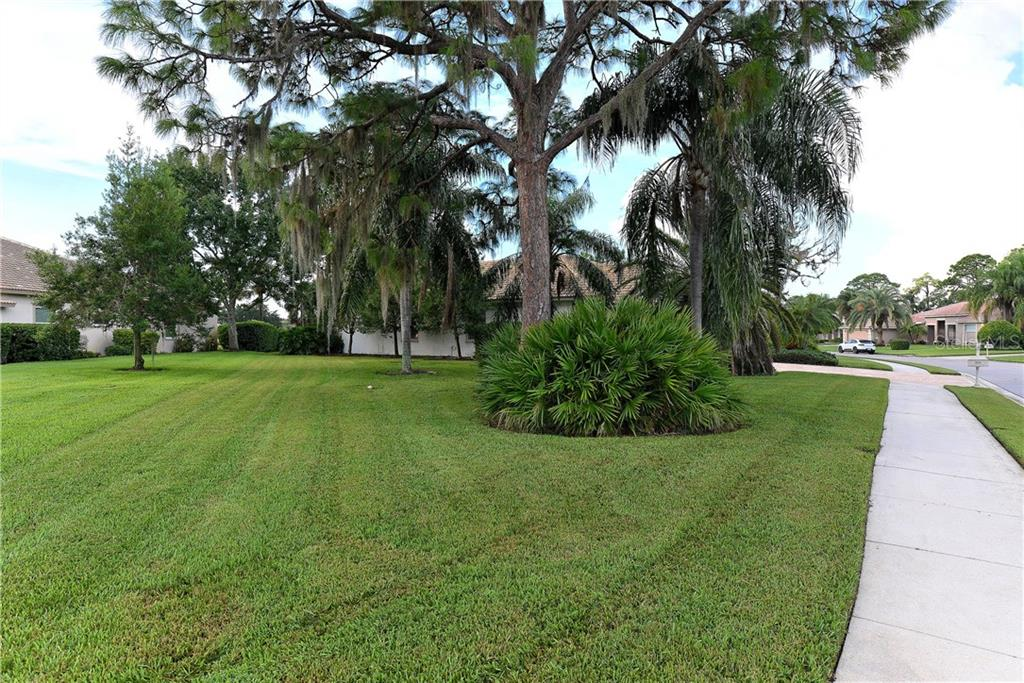 EXTRA side property of this home offers plenty of room for tossing a ball, badminton, bocci or just chilling. Maybe a spot for your own putting green? - Single Family Home for sale at 8753 Merion Ave, Sarasota, FL 34238 - MLS Number is A4165409
