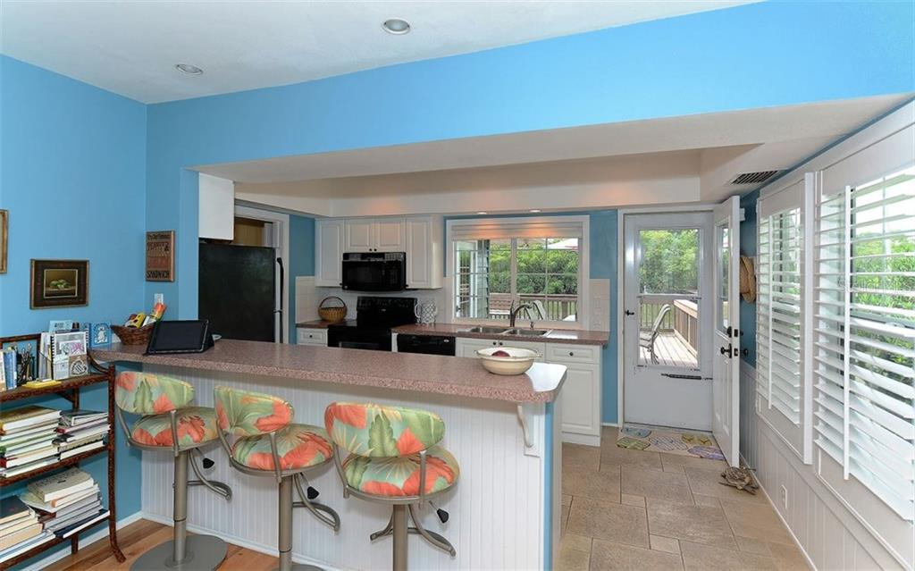 Single Family Home for sale at 6551 Bayou Hammock Rd, Longboat Key, FL 34228 - MLS Number is A4165873
