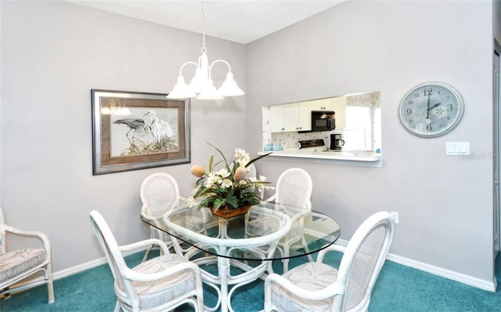 Dining room area with pass-thru to kitchen. - Condo for sale at 9630 Club South Cir #6103, Sarasota, FL 34238 - MLS Number is A4166105