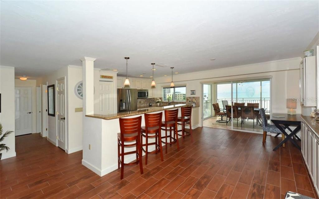 Kitchen with breakfast counter - Single Family Home for sale at 5830 Midnight Pass Rd #504, Sarasota, FL 34242 - MLS Number is A4166623