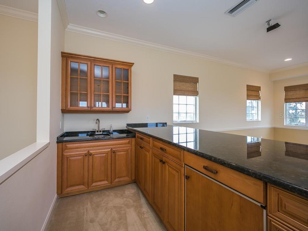 Upstairs bonus room has kitchen/bar area with ice maker. - Single Family Home for sale at 3313 Founders Club Dr, Sarasota, FL 34240 - MLS Number is A4169443