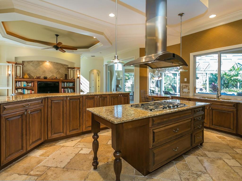 Adjacent to the island kitchen is a separate desk area/work station and a butler's pantry.  There is also a large walk in pantry. - Single Family Home for sale at 3313 Founders Club Dr, Sarasota, FL 34240 - MLS Number is A4169443