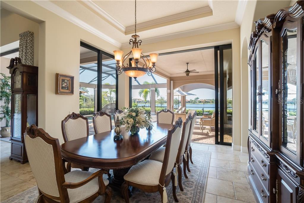 Dining area overlooking lanai, pool and lake - Single Family Home for sale at 16318 Daysailor Trl, Lakewood Ranch, FL 34202 - MLS Number is A4170081